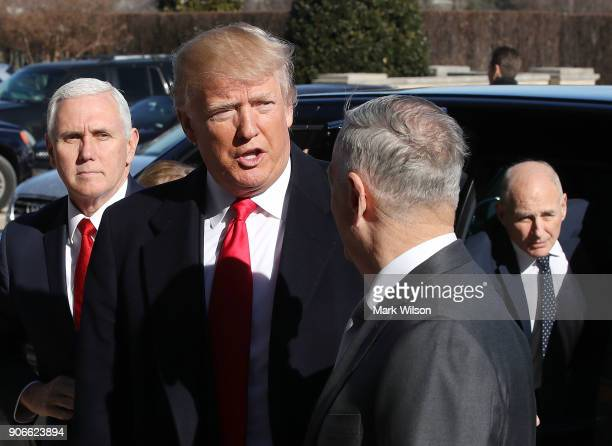 S President Donald Trump is greeted by Defense Secretary Jim Mattis after arriving for a meeting at the Pentagon on January 18 2018 in Arlington...