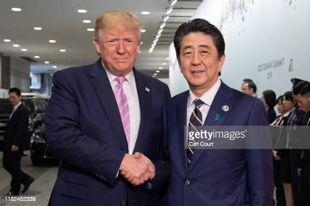 President Donald Trump is greeted by Japan's Prime Minister, Shinzo Abe, as he arrives on the first day of the G20 summit on June 28, 2019 in Osaka,...