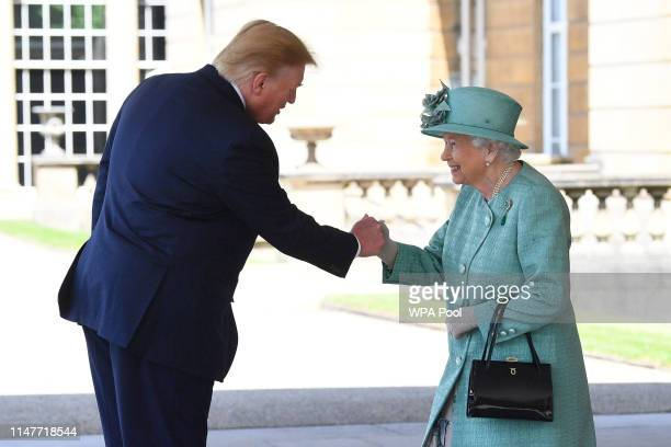 President Donald Trump is greeted by Queen Elizabeth II at Buckingham Palace on June 3, 2019 in London, England. President Trump's three-day state...