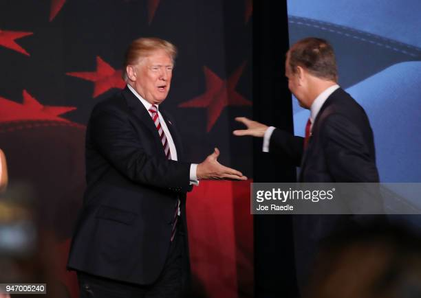 S President Donald Trump is greeted by Rep Mario DiazBalart as he arrives for a roundtable discussion about the Republican $15 trillion tax cut...