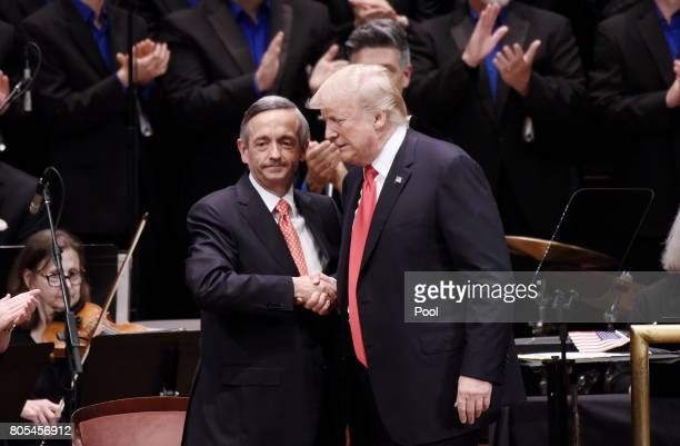 US President Donald Trump is greeting by Pastor Robert Jeffress during the Celebrate Freedom Rally at the John F Kennedy Center for the Performing...