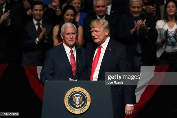 S President Donald Trump is introduced by Vice President Mike Pence at the Manuel Artime Theater in the Little Havana neighborhood on June 16 2017 in...