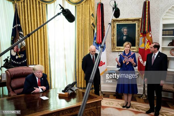President Donald Trump is joined by Food and Drug Administration head Stephen Hahn, White House coronavirus task force coordinator Dr. Deborah Birx...