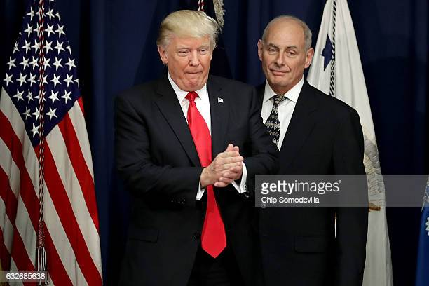 US President Donald Trump is joined by Homeland Security Secretary John Kelly during a visit to the Department of Homeland Security January 25 2017...