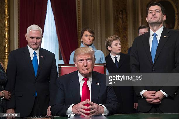 US President Donald Trump is joined by the Congressional leadership and his family before formally signing his cabinet nominations into law in the...