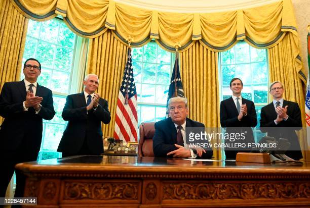 US President Donald Trump is joined by US Secretary of the Treasury Steven Mnuchin US Vice President Mike Pence Senior Advisor to the President Jared...