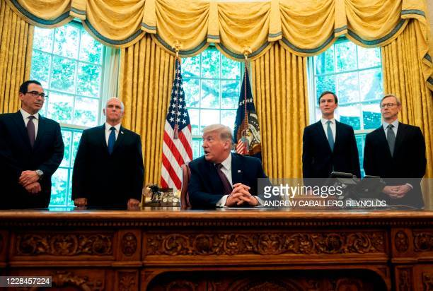 President Donald Trump is joined by US Secretary of the Treasury Steven Mnuchin, US Vice President Mike Pence, Senior Advisor to the President Jared...
