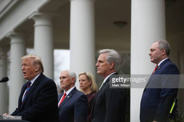 S President Donald Trump is joined by Vice President Mike Pence Homeland Security secretary Kirstjen Nielsen House Minority Leader Kevin McCarthy and...