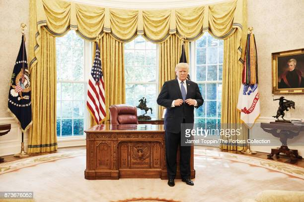 President Donald Trump is photographed for Forbes Magazine on October 6 2017 in the Oval Office in Washington DC PUBLISHED IMAGE CREDIT MUST READ...