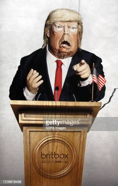 President Donald Trump is pictured in this panel. Caricatures of politicians on large advertisement board for satirical television puppet show...