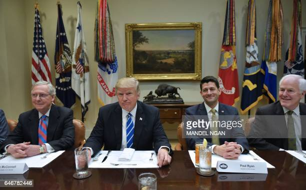 US President Donald Trump is seated for a lunch with Republican party House and Senate leadership including from left Senate Majority Leader Mitch...