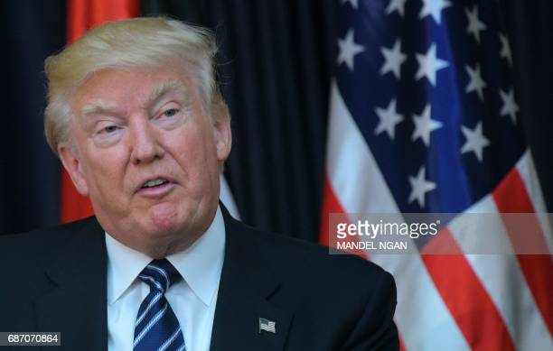 US President Donald Trump is seen during a joint press conference with the Palestinian leader at the presidential palace in the West Bank city of...