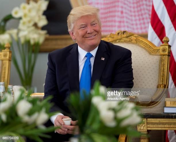 US President Donald Trump is seen during a meeting with Saudi Arabia's King Salman bin Abdulaziz Al Saud at the King Khalid International Airport in...