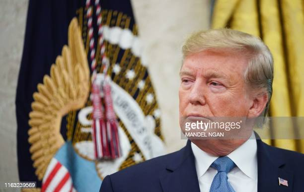 US President Donald Trump is seen during the presentation ceremony for the Presidential Medal of Freedom to Celtics basketball legend Bob Cousy in...