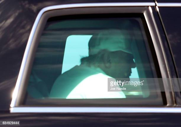 President Donald Trump is seen in his vehicle driving to MaraLago resort after visiting his golf course on February 12 2017 in West Palm Beach...