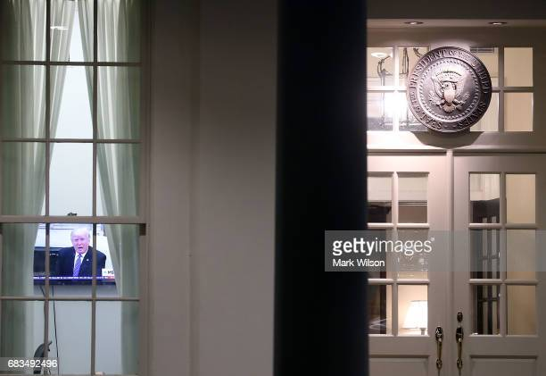President Donald Trump is seen on a television news show in the West Wing of the White House, on May 15, 2017 in Washington, DC. Earlier, National...