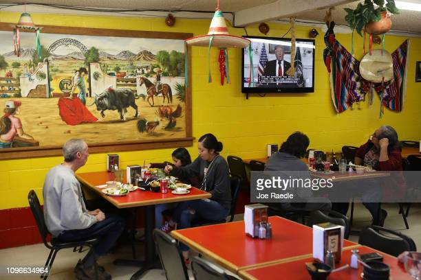 President Donald Trump is seen on the television at the El Toro Bronco restaurant as he delivers a speech on January 19 2019 in El Paso Texas The US...