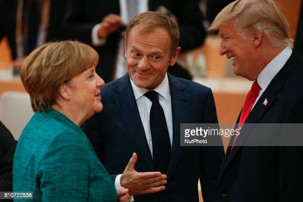 US president Donald Trump is seen with European Council president Donald Tusk and German chancellor Angela Merkel ahead of the thrid plenary session...