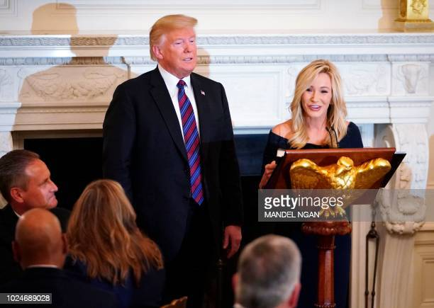 US President Donald Trump is seen with Pastor Paula White at an event honoring Evangelical leadership in the State Dining Room of the White House on...