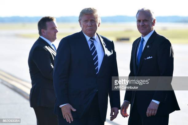 US President Donald Trump is seen with South Carolina Governor Henry McMaster upon arrival at GreenvilleSpartanburg International Airport in Greer...