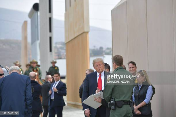 US President Donald Trump is shown border wall prototypes in San Diego California on March 13 2018 / AFP PHOTO / MANDEL NGAN