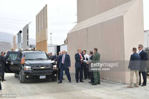 US President Donald Trump is shown border wall prototypes with White House Chief of Staff John Kelly in San Diego California on March 13 2018 / AFP...