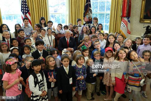 S President Donald Trump is surrounded by the children of members of the media and White House staff during Take Your Child To Work Day in the Oval...