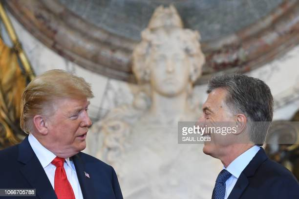 President Donald Trump is welcomed by Argentina's President Mauricio Macri at Casa Rosada presidential house in Buenos Aires, on November 30 to hold...