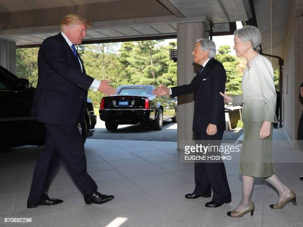 US President Donald Trump is welcomed by Emperor Akihito and Empress Michiko at the Imperial Palace in Tokyo on November 6 2017 President Donald...