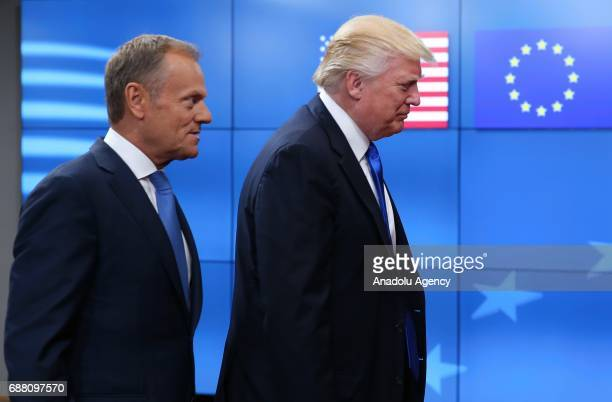 S President Donald Trump is welcomed by European Council President Donald Tusk as part of the NATO meeting in Brussels Belgium on May 25 2017