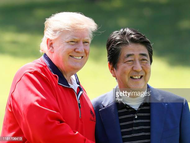 S President Donald Trump is welcomed by Japanese Prime Minister Shinzo Abe as he arrives to play golf at Mobara Country Club on May 26 2019 in Chiba...