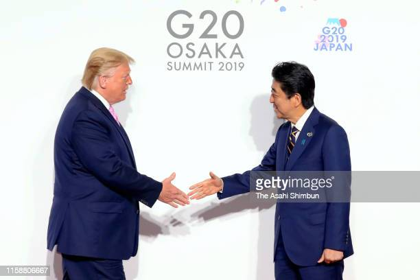 S President Donald Trump is welcomed by Japanese Prime Minister Shinzo Abe on the first day of the G20 summit on June 28 2019 in Osaka Japan World...