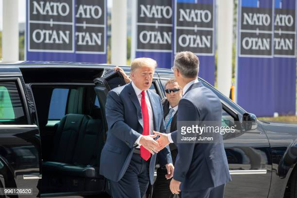 President Donald Trump is welcomed by NATO Secretary General Jens Stoltenberg at the 2018 NATO Summit at NATO headquarters on July 11 2018 in...