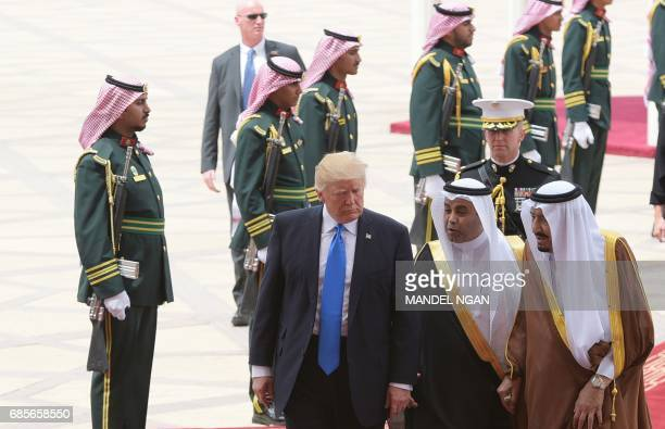 US President Donald Trump is welcomed by Saudi King Salman bin Abdulaziz alSaud upon arrival at King Khalid International Airport in Riyadh on May 20...