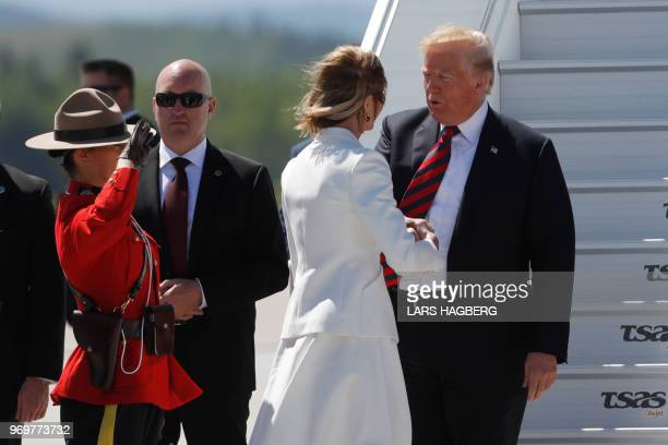 US President Donald Trump is welcomed by US Ambassador to Canada Kelly Knight Craft as he arrives at Canadian Forces Base Bagotville Canada on June 8...