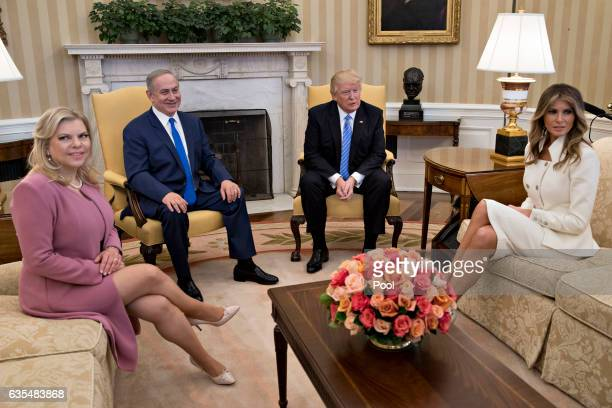 US President Donald Trump Israel Prime Minister Benjamin Netanyahu his wife Sara Netanyahu and US first lady Melania Trump sit in the Oval Office of...