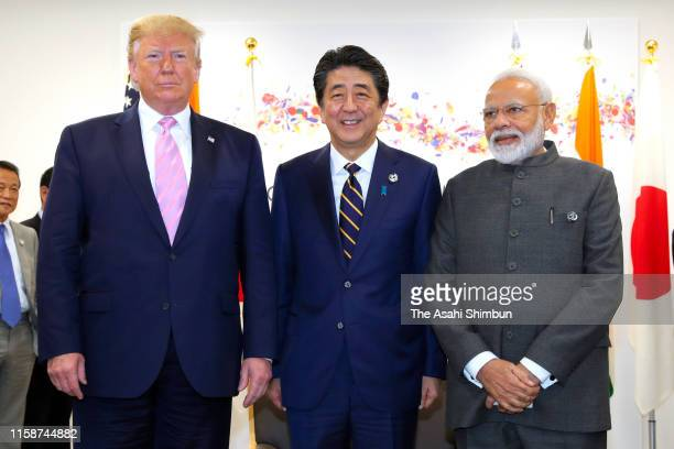 US President Donald Trump Japanese Prime Minister Shinzo Abe and Indian Prime Minister Narendra Modi pose for photographs prior to their trilateral...