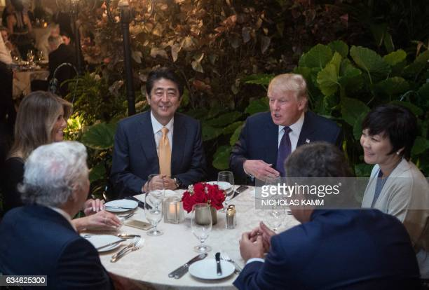 President Donald Trump, Japanese Prime Minister Shinzo Abe , his wife Akie Abe , US First Lady Melania Trump and Robert Kraft ,owner of the New...