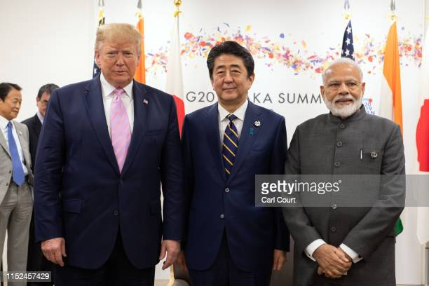 President Donald Trump, Japan's Prime Minister, Shinzo Abe and India's Prime Minister, Narendra Modi, take part in a trilateral meeting on the first...