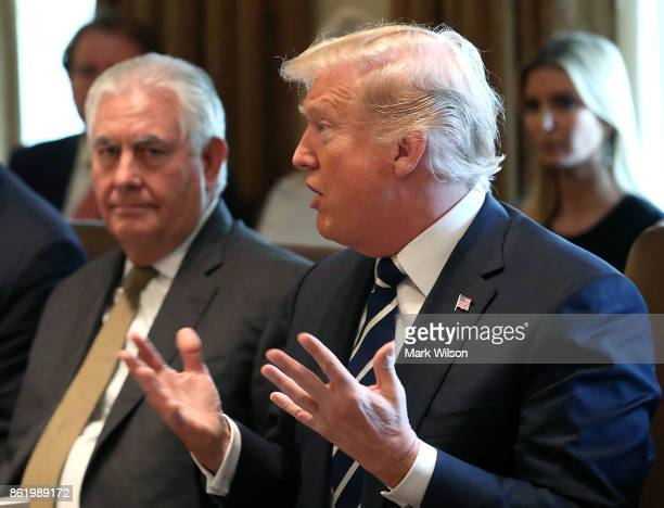 US President Donald Trump joined by US Secretary of State Rex Tillerson speaks to the media during a meeting with his cabinet at the White House on...