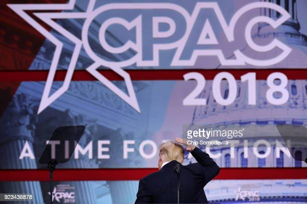 S President Donald Trump jokes about covering his bald spot while addressing the Conservative Political Action Conference at the Gaylord National...