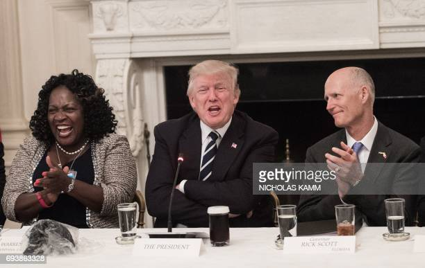 President Donald Trump jokes during an infrastructure summit with governors and mayors as Acquanetta Warren , mayor of Fontana, California, and...