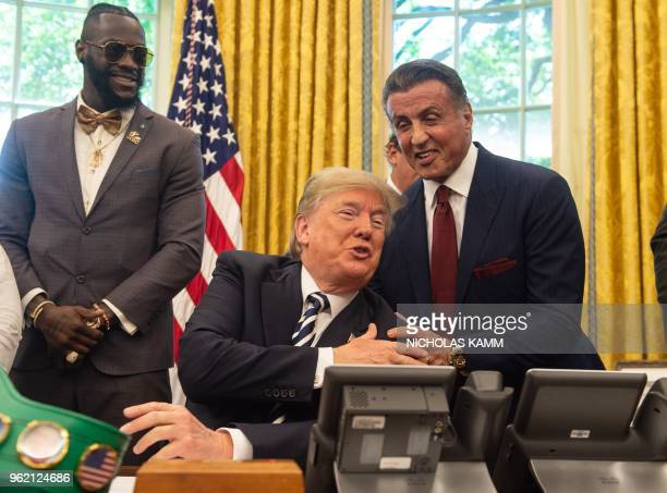 US President Donald Trump jokes with actor Sylvester Stallone before signing a posthumous pardon for former world champion boxer Jack Johnson in the...