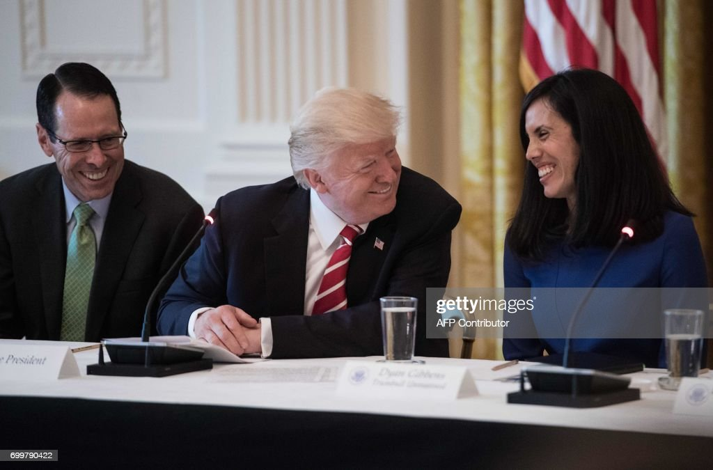US President Donald Trump jokes with Dyan Gibbens , CEO of Trumbull