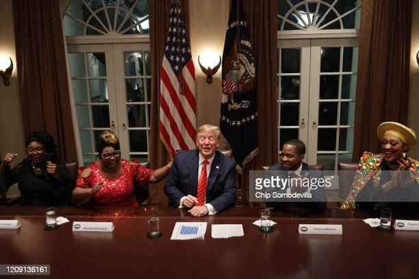 President Donald Trump jokes with guests Lynette 'Diamond' Hardaway, Rochelle 'Silk' Richardson, Terrence Williams and Angela Stanton-King during a...