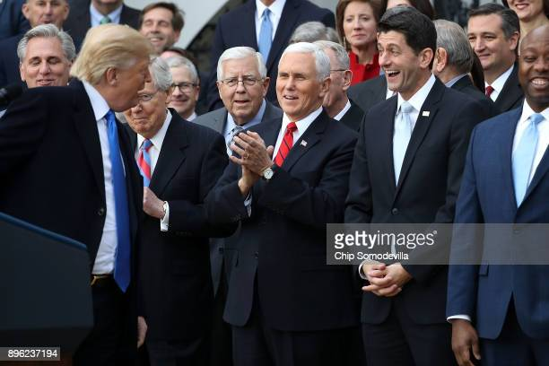 S President Donald Trump jokes with Senate Majority Leader Mitch McConnell Sen Mike Enzi Vice President Mike Pence Spaker of the House Paul Ryan and...