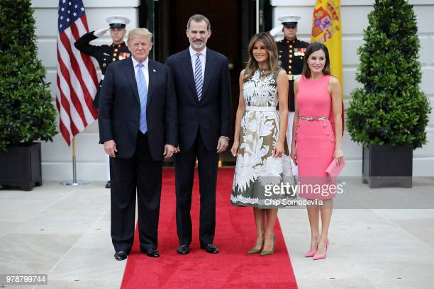 First Lady Melania Trump attends a meeting with US President Donald Trump King Felipe VI and Queen Letizia of Spain in the Oval Office at The White...