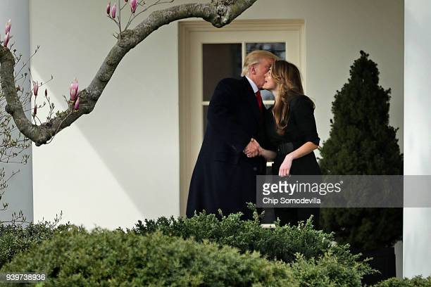 President Donald Trump kisses Communications Director Hope Hicks on her last day of work at the White House before he departs March 29, 2018 in...