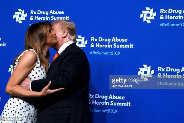 US President Donald Trump kisses First Lady Melania Trump as they attend the Rx Drug Abuse and Heroin Summit in Atlanta Georgia on April 24 2019