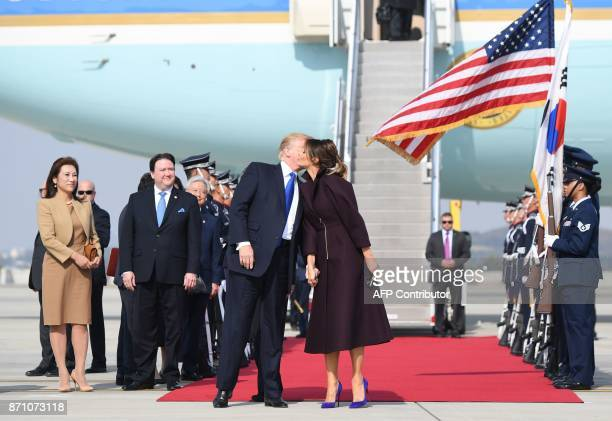 US President Donald Trump kisses First Lady Melania Trump upon arriviing in Osan on November 7 2017 Donald Trump's marathon Asia tour moves to South...